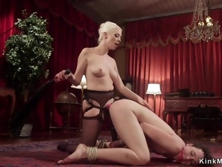 Blond Hair Girl whips lesbian in upside down suspension