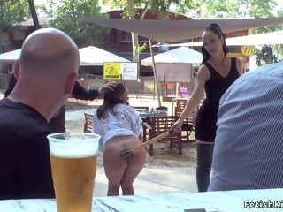 Petite Euro slave sucks in public
